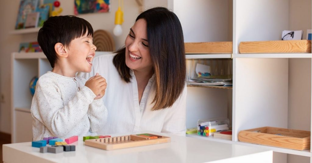 kid-playing-with-a-tetris-wood-puzzle-and-mother